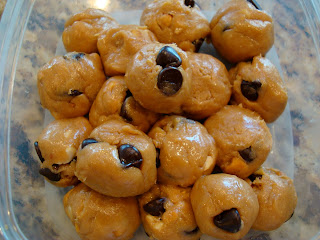 No-Bake Vegan Peanut Butter Chocolate Chip Cookie Dough Balls stacked in clear container