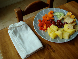 Childs plate full of fruits and vegetables