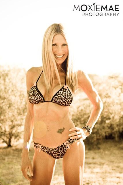 Moxiemae Photography of woman wearing leopard print bikini
