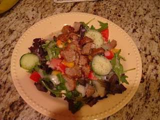 Mixed salad in shallow bowl topped with sliced turkey meatballs