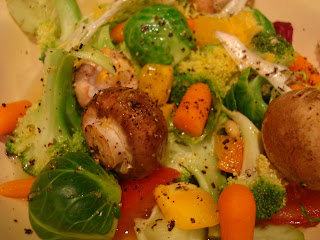 Mixed raw vegetables in white bowl seasoning