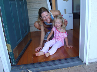 Woman and little girl on floor smiling