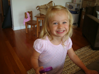 Smiling young girl in pink shirt