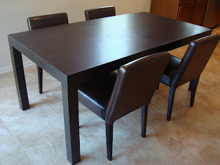 West Elm Chocolate colored table with four chairs