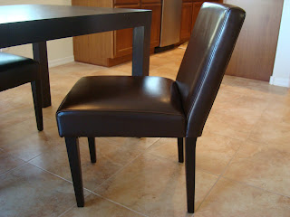 Leather dining room chair pulled slightly. away from table