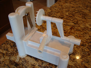 White spiralizer sitting on kitchen countertop