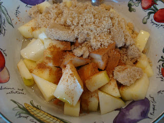 Diced apples, cinnamon, brown sugar and agave in bowl