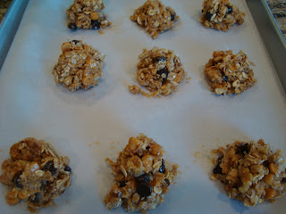 Maple Nut Chocolate Oat Clusters shaped on parchment lined baking sheet