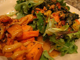 Roasted Sweet Potatoes and Carrots with side salad on plate