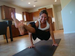 Woman doing Astavakrasana Variation yoga pose