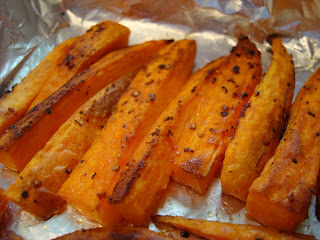 Close up of Roasted Sweet Potatoes on foil lined pan