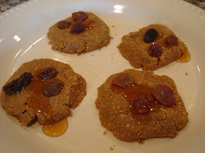 No-Bake Vegan Maple Flaxseed Cookies topped with raisins and syrup