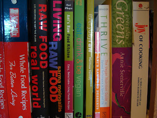 Various cookbooks stacked on shelf