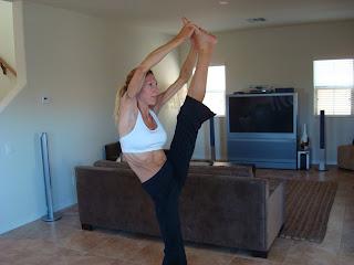 Woman doing Utthita Hasta Padangustasana yoga pose