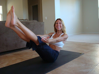 Woman doing Navasana yoga pose