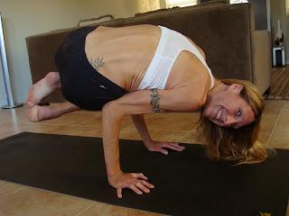 Woman doing Parsva Bakasana yoga pose
