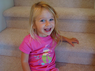 Smiling young girl sitting on steps