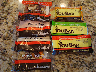 You Bars and packages of Trail Mix on countertop