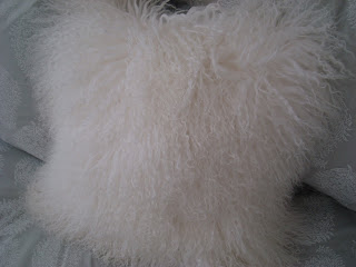 White fluffy and fuzzy accent pillow