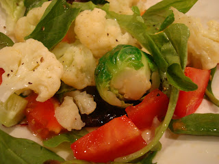 Mixed greens with vegetables topped with dressing