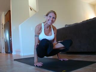 Woman doing Tolasana yoga pose