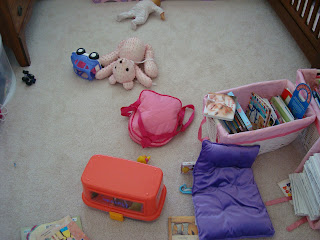 Childs bedroom showing messy items across floor