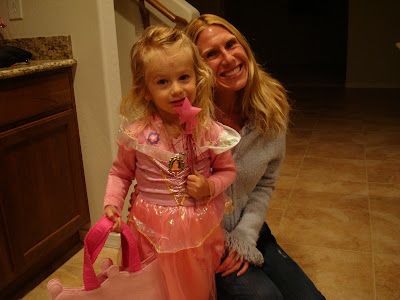 Woman and young girl in princes fairy costume smiling