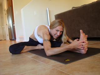 Woman doing Janu Sirsasana yoga pose