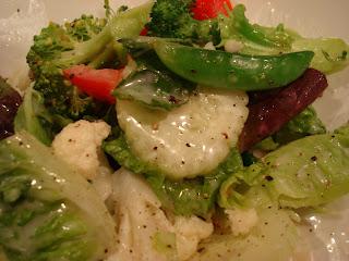 Salad tossed with Raw Vegan Creamy Tahini Dressing