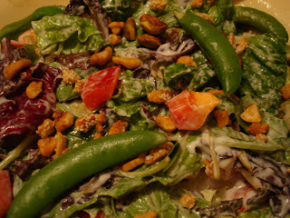 Tossed salad with dressing close up
