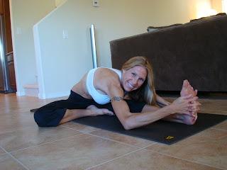 Woman doing Janu Shirsana A yoga pose