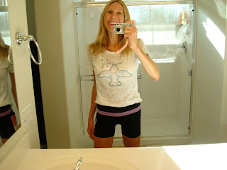 Woman taking photo in mirror wearing Lululemon clothing