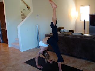 Woman doing Eka Pada Urdhva Dhanurasana yoga pose