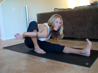 Woman doing Marichyasana A yoga pose