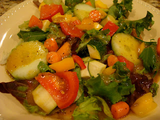 Salad topped with Holiday Orange Spice Vinaigrette