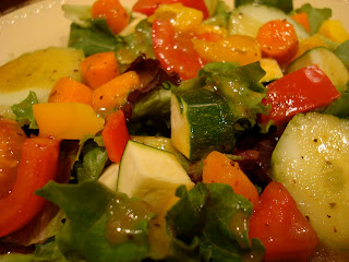 Close up of vegetables on salad topped with homemade dressing