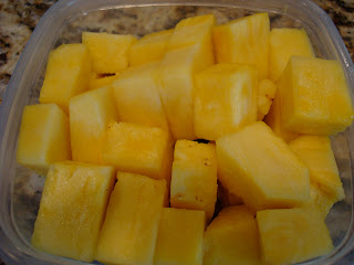 Container full of diced pineapple