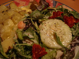 Salad with CreamyVegan Cesar-Inspired Tahini Dressing topped with sun dried tomatoes