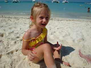 Young girl playing in sand at beach