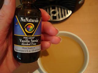Hand holding NuNaturals Vanilla Stevia Drops