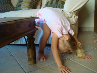 Young girl practicing Downward Dog yoga pose
