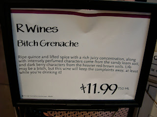 Sign that says R Wines Bitch Grenache