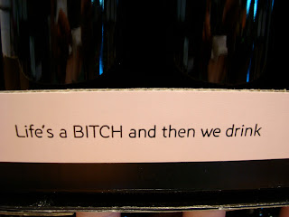 Slogan on wine: Life's a Bitch and then we drink