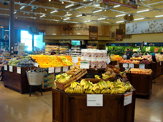 Inside grocery store in produce section