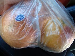 Two grapefruit in bag