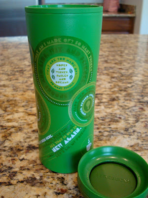 Green Coffee Go Cup on countertop with lid off