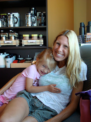 Woman in chair with child hugging her smiling