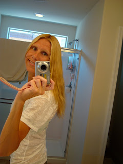 Mirror photo of woman showing new hair color