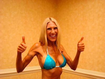 Woman giving thumbs up in bikini
