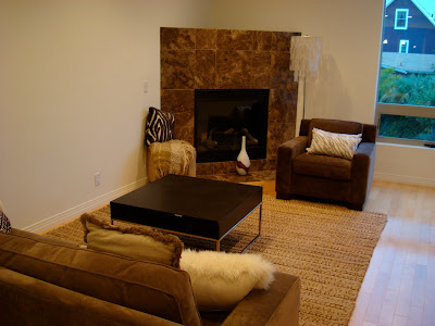 Living room set up with furniture and fireplace